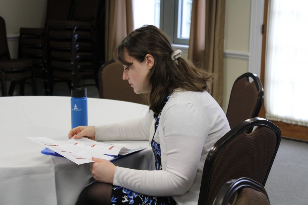 Kyra Kopacz looks over workshop packet
