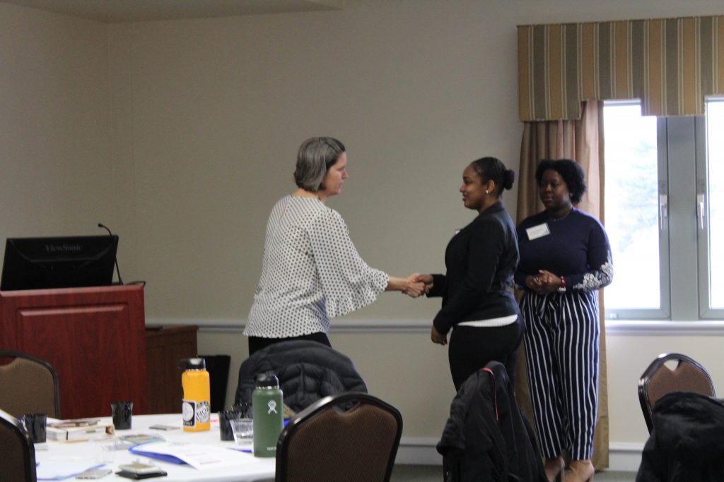 Trisha Shafer from CDC practices a firm handshake with students