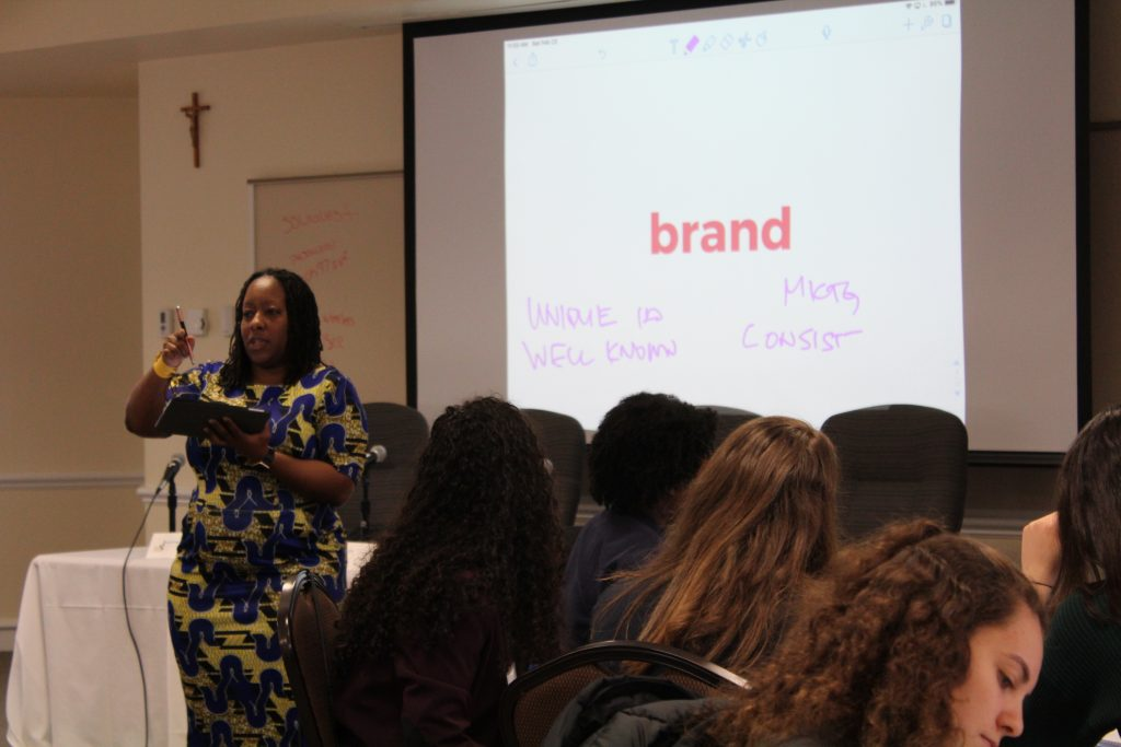 Dr. Janeé Burkhalter discusses what a brand ism during her workshop